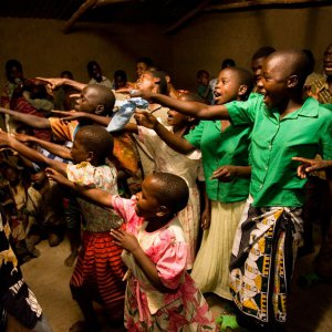 Choir performs at a community gathering at the Baha'i center in Mwinilunga, Malawi